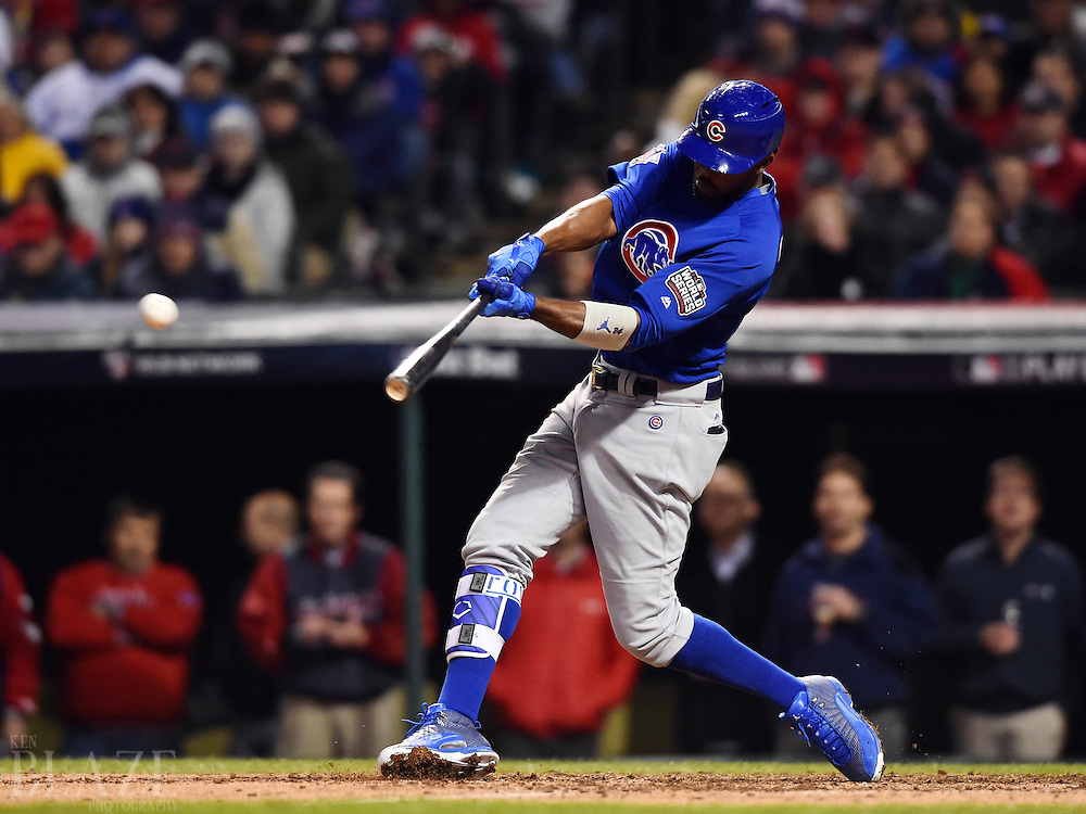 Oct 26, 2016; Cleveland, OH, USA; Chicago Cubs center fielder Dexter Fowler hits a single against the Cleveland Indians in the 7th inning in game two of the 2016 World Series at Progressive Field. Mandatory Credit: Ken Blaze-USA TODAY Sports