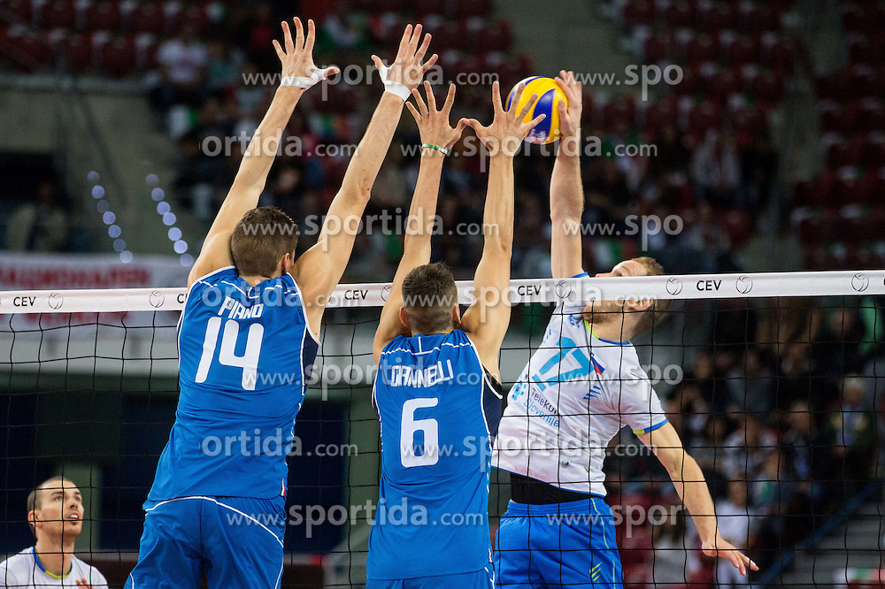 Matteo Piano of Italy and Simone Giannelli of Italy vs Tine Urnaut #17 of Slovenia during volleyball match between National teams of Slovenia and Italy in 1st Semifinal of 2015 CEV Volleyball European Championship - Men, on October 17, 2015 in Arena Armeec, Sofia, Bulgaria. Photo by Vid Ponikvar / Sportida