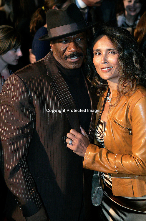 Actor Vhing Rhames and his wife Deborah Reed(R) arrive for a special screening for his new film Mission Impossible III at the Ziegfeld Theater in New York, May 3, 2006. Keith Bedford