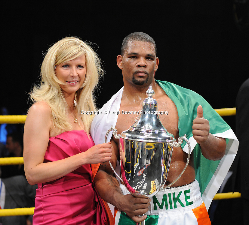 Mike Perez and partner following presentation of the trophy for winning Prizefighter International on Saturday 7th May 2011. Prizefighter / Matchroom. Photo credit © Leigh Dawney. Alexandra Palace, London.