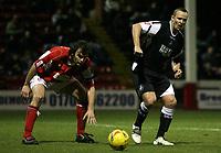 Photo: Paul Thomas.<br /> Rotherham United v Swansea City. Coca Cola League 2. 27/02/2007.<br /> <br /> Lee Trundle (R) of Swansea passes it past Ian Sharps.
