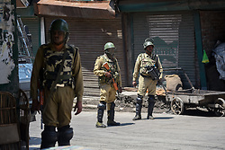 May 25, 2019 - Srinagar, Jammu and Kashmir, India - Indian paramilitary officers seen standing on guard during the restrictions in Srinagar..Curfew continued in parts of Kashmir for second straight day following killing of militant commander Zakir Musa. Musa, the head of the Ansar Ghazwat-ul-Hind, was killed in a gunfight at Dadsara village of Tral in the south Kashmir's Pulwama district on Friday. (Credit Image: © Idrees Abbas/SOPA Images via ZUMA Wire)