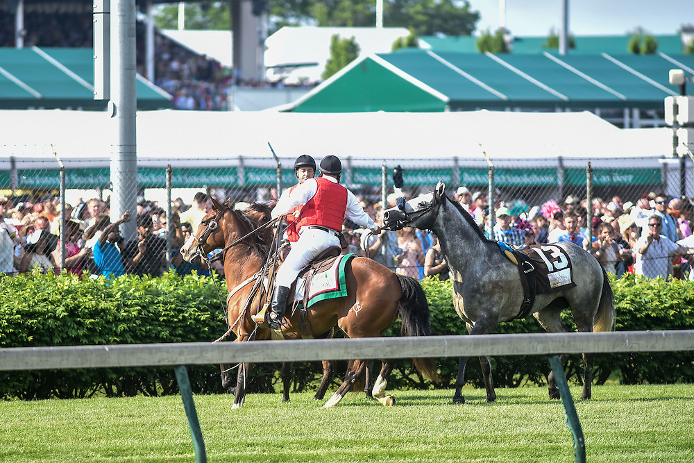 Outriders secure the #13 horse that fell in the Woodford Reserve turf classic race before the 142nd running of the Kentucky Derby. May 7, 2016