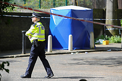 May 6, 2018 - London, London, United Kingdom - Southwark shooting. ..Police agents keeping the crime scene...A boy, in his 17, dies in Southwark incident. .Police called to reports of gunshots on Cooks Road in Southwark at about 6.05pm on Saturday..The teenager was found injured on nearby Warham Street and was pronounced dead just before 7pm. (Credit Image: © Gustavo Valiente/i-Images via ZUMA Press)