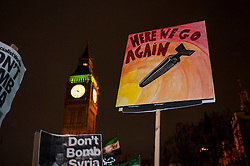 © Licensed to London News Pictures. 02/12/2015. London, UK. Anti-war protestors in Parliament Square react to learning that MPs had just voted for the UK to commence air strikes in Syria.  Photo credit : Stephen Chung/LNP