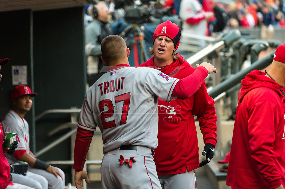 Mike Trout #27 and Jered Weaver #36 of the Los Angeles Angels prepare before a game against the Minnesota Twins on April 16, 2013 at Target Field in Minneapolis, Minnesota.  The Twins defeated the Angels 8 to 6.  Photo: Ben Krause