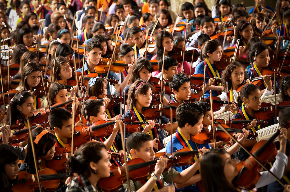 Children trained by El Sistema perform for Gustavo Dudamel, Antonio Abreu, and members of the Los Angeles Philharmonic in Caracas on Februrary 16, 2012.  Some critics believe that Antonio Abreu and Gustavo Dudamel, leaders of El Sistema, Venezuela's internationally acclaimed, state-funded classical music education program that serves underpriviledged children, should take a political stand against Chavez and his anti-democratic tendencies.