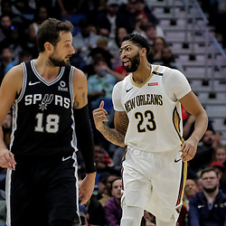 Nov 19, 2018; New Orleans, LA, USA; New Orleans Pelicans forward Anthony Davis (23) celebrates a basket as San Antonio Spurs guard Marco Belinelli (18) looks on during the second half at the Smoothie King Center. Mandatory Credit: Derick E. Hingle-USA TODAY Sports
