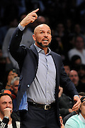 Brooklyn Nets coach Jason Kidd directs his team against the Toronto Raptors during an NBA basketball game on Monday, March 10, 2014 at Barclays Center in New York. (AP Photo/Kathy Kmonicek)