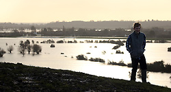 © Licensed to London News Pictures. 02/02/2014. Burrowbridge, UK Floodwater seen across the levels from Burrow Mump in Burrowbridge. Burrowbridge on the Somerset levels today. The River Parrett broke its banks again at 9.15 am today 2nd February 2014. Photo credit : Jason Bryant/LNP