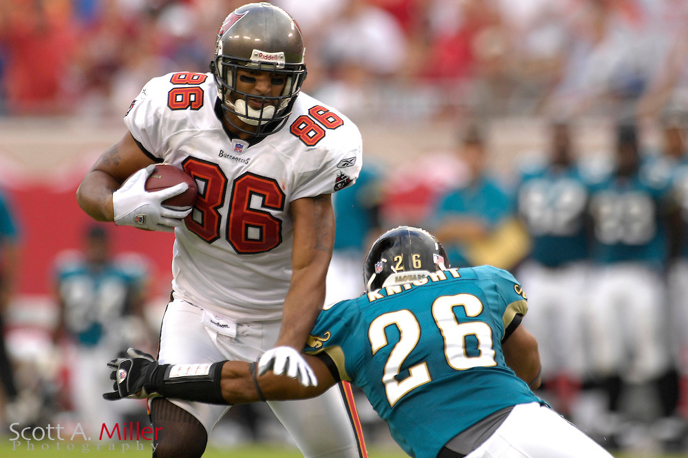 Tampa Bay Buccaneers receiver (86) Jerramy Stevens is tackled by Jacksonville Jaguars defender (26) Sammy Knight during the second quarter of their game at Raymond James Stadium on Oct. 28, 2007 in Tampa, Florida.       ..©2007 Scott A. Miller