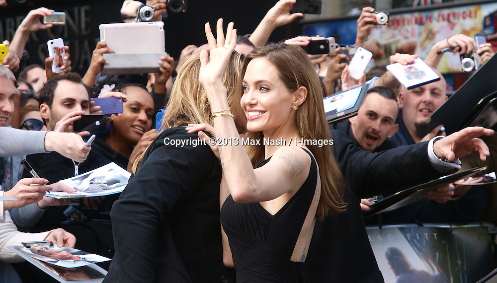 Angelina Jolie with Brad Pitt as they arrive for the World War Z UK film premiere at The Empire, Leicester Square, London, United Kingdom, <br /> Sunday, 2nd June 2013<br /> <br /> Picture by Max Nash / i-Images