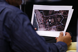 July 26, 2017 - Oxnard, California, USA - A person holds a satellite view of the puente Power Plant during a California Energy Commission hearing to discuss the impact of the plant's construction in Oxnard, California. The gas-fired electrical generating station planned for construction at an existing power plant site at Oxnard's Mandalay Beach is nearing a final decision. There are currently three gas-fired plants along the city's coast and the Puente plant would become the fourth if approved. (Credit Image: © Joel Angel Juarez via ZUMA Wire)