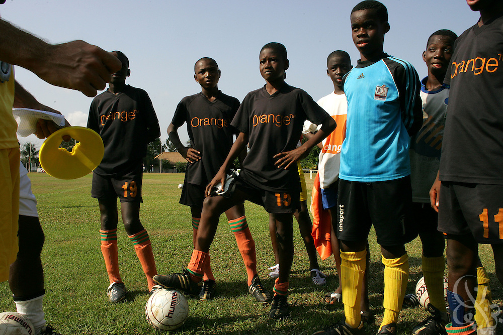 Teenage Ivorian football players listen as coaches explain the plan for drills during a morning training session at the ASEC football academy February 16, 2006 in Abidjan, Côte d'Ivoire. ASEC academy has an established history of producing top notch footballers who go on to play in the top European football leagues.