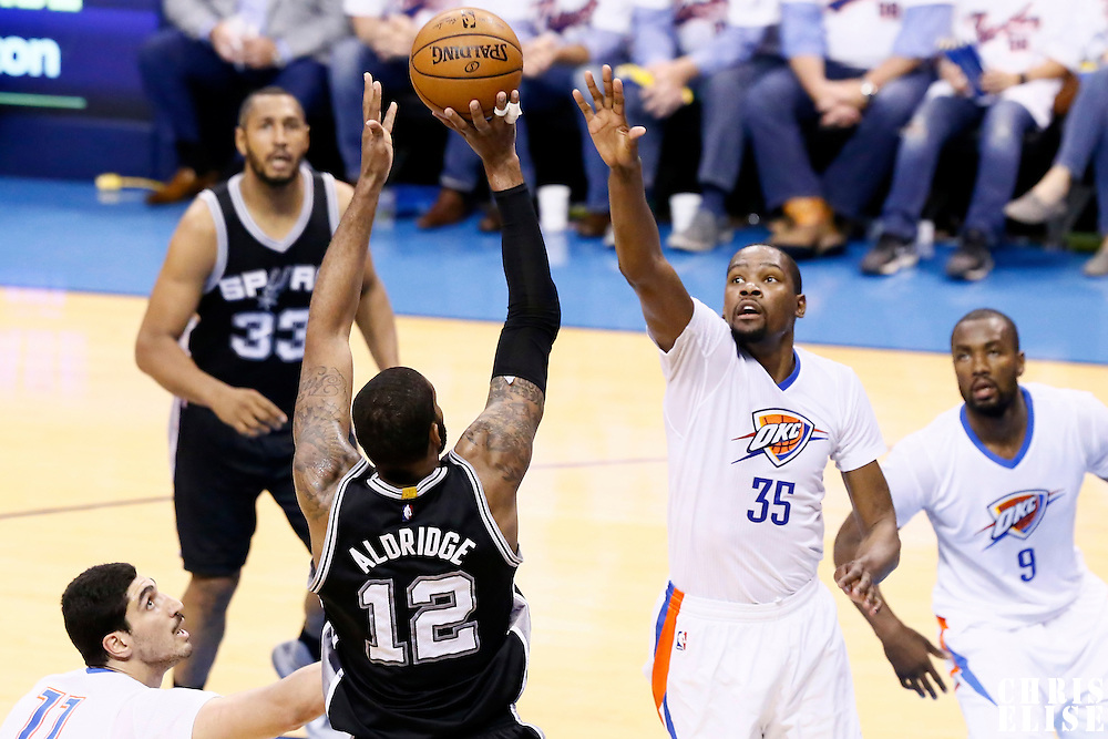 06 May 2016: San Antonio Spurs forward LaMarcus Aldridge (12) takes a jump shot over Oklahoma City Thunder forward Kevin Durant (35) during the San Antonio Spurs 100-96 victory over the Oklahoma City Thunder, during Game Three of the Western Conference Semifinals of the NBA Playoffs at the Chesapeake Energy Arena, Oklahoma City, Oklahoma, USA.