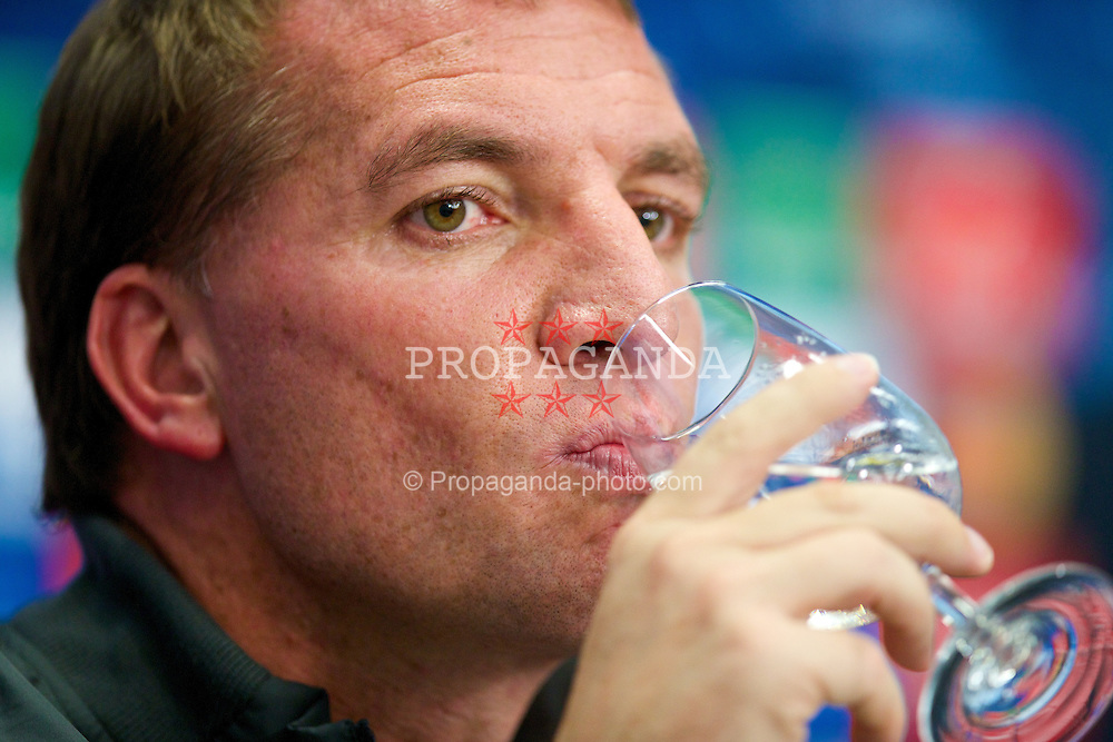 BASEL, SWITZERLAND - Tuesday, September 30, 2014: Liverpool's manager Brendan Rodgers drinks from a glass of water during a press conference at the St. Jakob Stadium ahead of the UEFA Champions League Group B match against FC Basel. (Pic by David Rawcliffe/Propaganda)