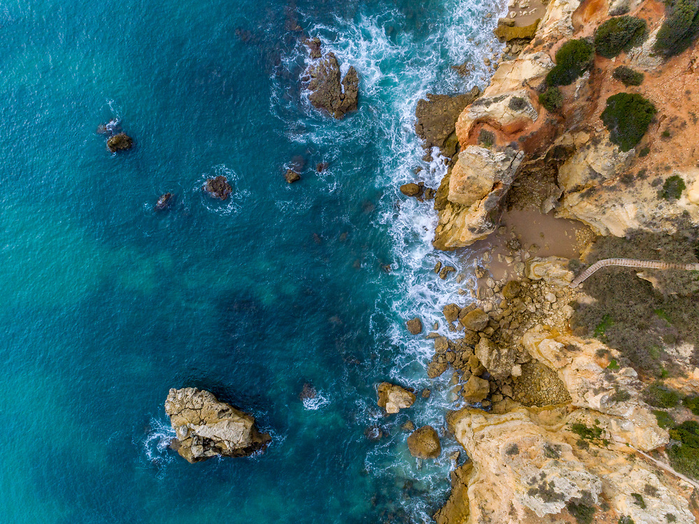 Aerial beautiful rocks and cliffs seascape shore view near Albufeira, Algarve, Portugal.