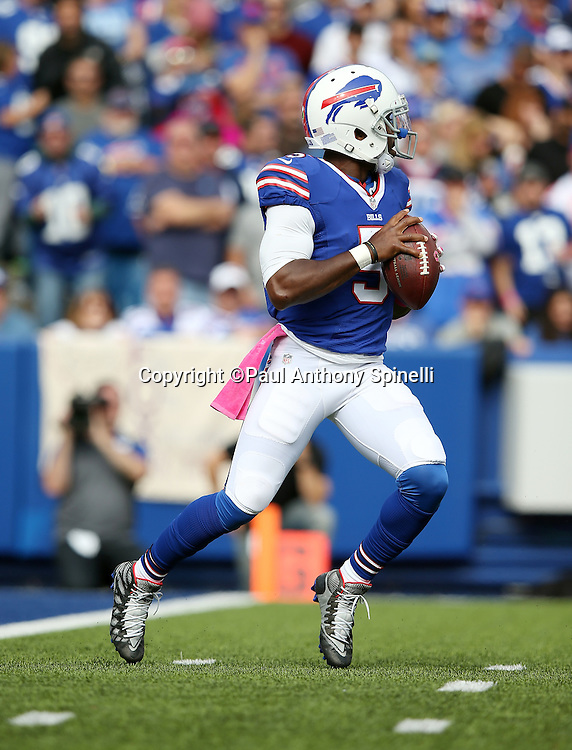 Buffalo Bills quarterback Tyrod Taylor (5) drops back to pass near his own end zone in the first quarter during the 2015 NFL week 4 regular season football game against the New York Giants on Sunday, Oct. 4, 2015 in Orchard Park, N.Y. The Giants won the game 24-10. (©Paul Anthony Spinelli)