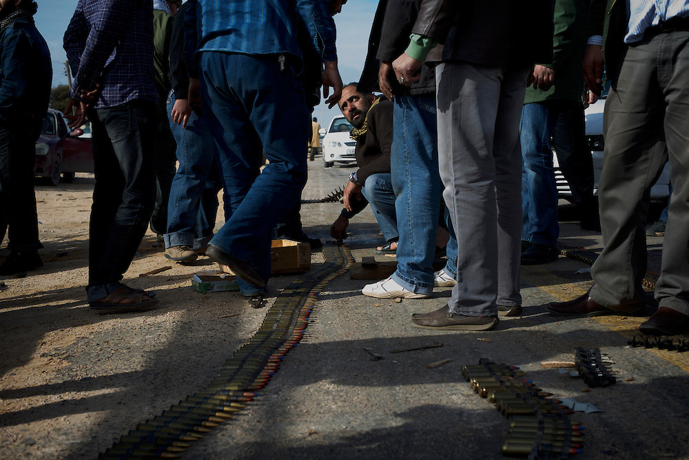 Rebel forces prepare ammunition for an attack to take over the pro-Gaddafi held city of Ajdabiya.
