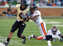 Wake Forest wide receiver D.J. Boldin (4) is pushed out of bounds by Virginia cornerback Vic Hall (4).  The Wake Forest Demon Deacons defeated the Virginia Cavaliers 24-17 in NCAA Division 1 Football at BB&T Field on the campus of Wake Forest University in Winston-Salem, North Carolina on November 8, 2008.