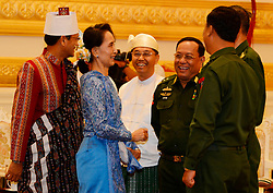 Chairperson of Myanmar's ruling National League for Democracy (NLD) Aung San Suu Kyi (2nd L) talks with military assigned ministers during the president power handover ceremony at the Presidential Palace in Nay Pyi Taw, Myanmar, March 30, 2016. Myanmar's new President U Htin Kyaw pledged on Wednesday to implement four policies based on the policies of the ruling NLD, led by Aung San Suu Kyi. EXPA Pictures © 2016, PhotoCredit: EXPA/ Photoshot/ MOI<br /> <br /> *****ATTENTION - for AUT, SLO, CRO, SRB, BIH, MAZ, SUI only*****