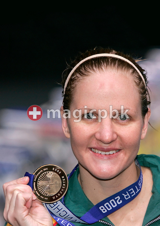 Kirsty COVENTRY of Zimbabwe poses with her gold medal after winning in a new world record time the women's 400m individual medley (IM) final in the Duncan Goodhew pool at the 9th FINA Swimming World Championships (25m) in Manchester, Great Britain, Wednesday, April 9, 2008. (Photo by Patrick B. Kraemer / MAGICPBK)