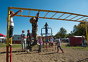 ucas Crow swings on the monkey bars at Snowden Lake during the Paw Paw Festival September 14, 2013 in Albany, Ohio.