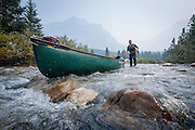 Dave Shively lines a canoe on the Bow River, Banff Alberta.