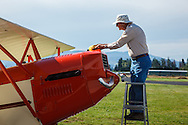 WAAAM's founder preparing a 1929 3C3-T Command Aire for flight
