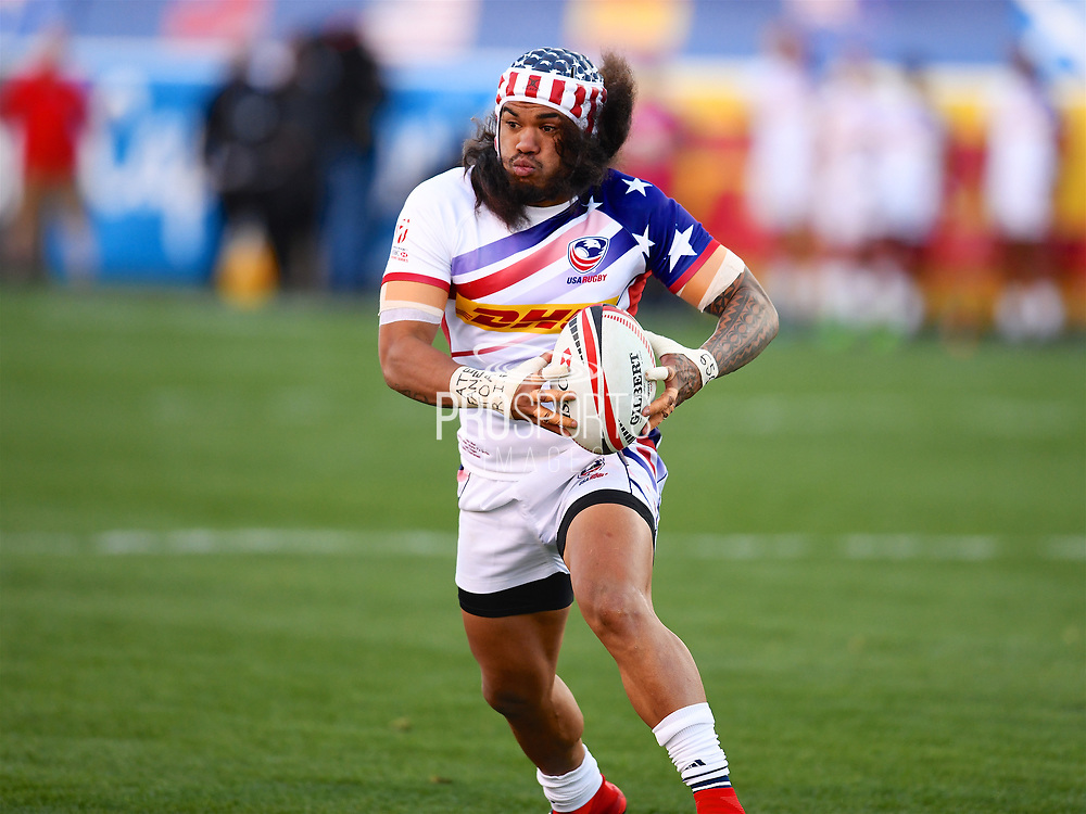 USA player Folau Niua looks for holes in the defence in the game USA vs Samoa during the USA Sevens Rugby Series at Sam Boyd Stadium, Las Vegas, USA on 2 March 2018. Picture by Ian  Muir.
