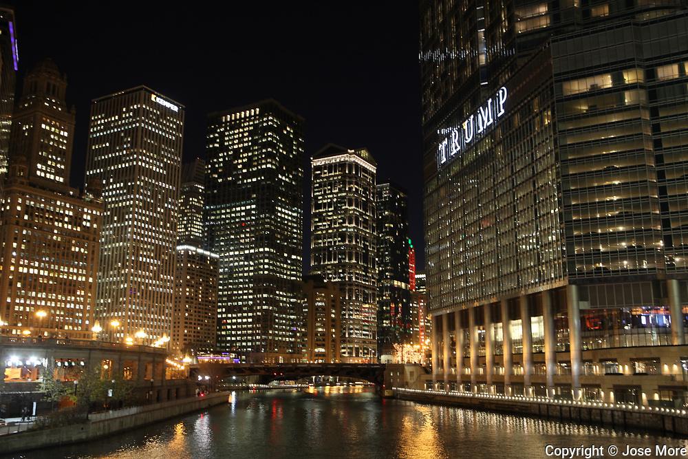 Trump International Hotel and Tower condominiums overlooking the Chicago River at night. The hotel is the target of many anti-Trump protests and rallies.  Photography by Jose More
