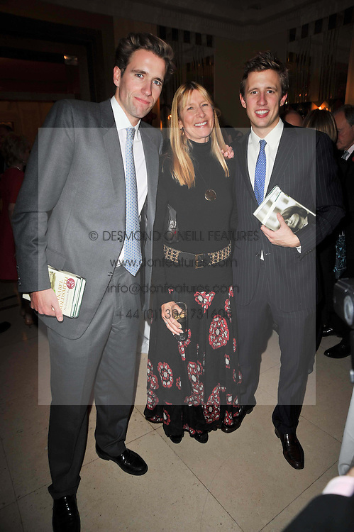LADY CARINA FROST and her sons, left, MILES and right, GEORGE at a party to celebrate the publiction of 'No Invitation Required' by Annabel Goldsmith, held at Claridge's, Brook Street, London on 11th November 2009.
