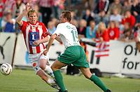 Fotball, Eliteserie, 25 juli 2004, Alfheim Stadion i Tromsø, TROMSØ IL - HAM KAM 0-3,  TILs Morten Pedersen og danske Jan Michaelsen<br /> FOTO: KAJA BAARDSEN/DIGITALSPORT