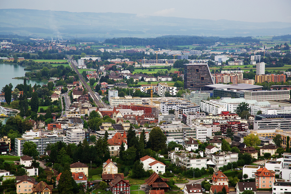 Commercial and residential buildings stand in Zug, Switzerland, on Friday, Aug. 24, 2012