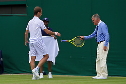 LONDON, ENGLAND - Tuesday, June 28, 2016: A line judge hands Richard Gasquet (FRA) his racquet back during the Gentlemen's Singles 1st Round match on day two of the Wimbledon Lawn Tennis Championships at the All England Lawn Tennis and Croquet Club. (Pic by Kirsten Holst/Propaganda)