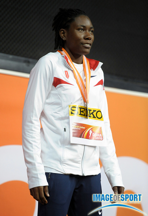 Mar 14, 2010; Doha, QATAR; Brittney Reese (USA) poses with the gold medal after winning the women's long jump at 21-11 3/4 (6.70m) in the IAAF World Indoor Championships at the Aspire Dome.