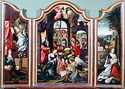 Adoration of the Shepherds'  triptych attributed to Flemish artist Cornelis Englebrechtsen (Engelberts 1468-1533).  Left panel shows the Annunciation; Centre the Adoration in the stable with Mary, Joseph, infant Jesus, Angels, Shepherd (with bagpipes) and Oxen; Right Virgin and Child. Oil on wood.