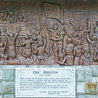 """Wall carving depicting the Filipino's """"People Power"""" Edsa Revolution, which led to the overthrow of the dictator Ferdinand Marcos."""
