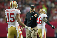 20 January 2013: Head coach Jim Harbaugh of the San Francisco 49ers speaks to Michael Crabtree while coaching against the Atlanta Falcons during the 49ers 28-24 victory over the Falcons in the NFC Championship Game at the Georgia Dome in Atlanta, GA.