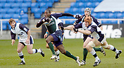 2004/05 Zurich Premiership,London Irish vs Sale Sharks, Madejski Stadium, Reading, ENGLAND:.Exiles Paul Sackey slips Christian Day's tackle as Irish attack in the first half...Photo  Peter Spurrier. .email images@intersport-images...