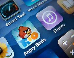 Close-up of screen of iPhone 4G smart phone showing angry birds game app