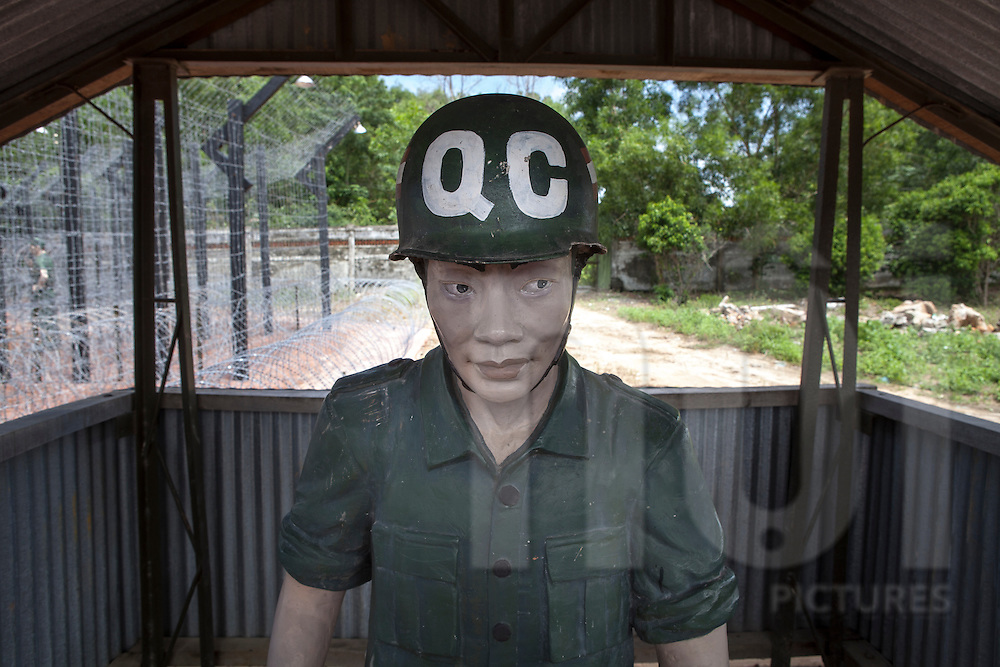 Phu quoc prison memorial, aka 'Coconut Tree Prison', highway 46. What is paradise for tourists today was once hell on earth for tens of thousands of Vietnamese revolutionaries, who were imprisoned here first by French colonial forces and later by the US-led southern Vietnamese 'puppet regime'. .Plastic dummy represents behaviours of army soldiers..Phu Quoc Island, Vietnam, Asia 2012