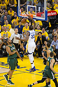 Golden State Warriors forward Kevin Durant (35) dunks the ball against the Utah Jazz during Game 1 of the Western Conference Semifinals at Oracle Arena in Oakland, Calif., on May 2, 2017. (Stan Olszewski/Special to S.F. Examiner)