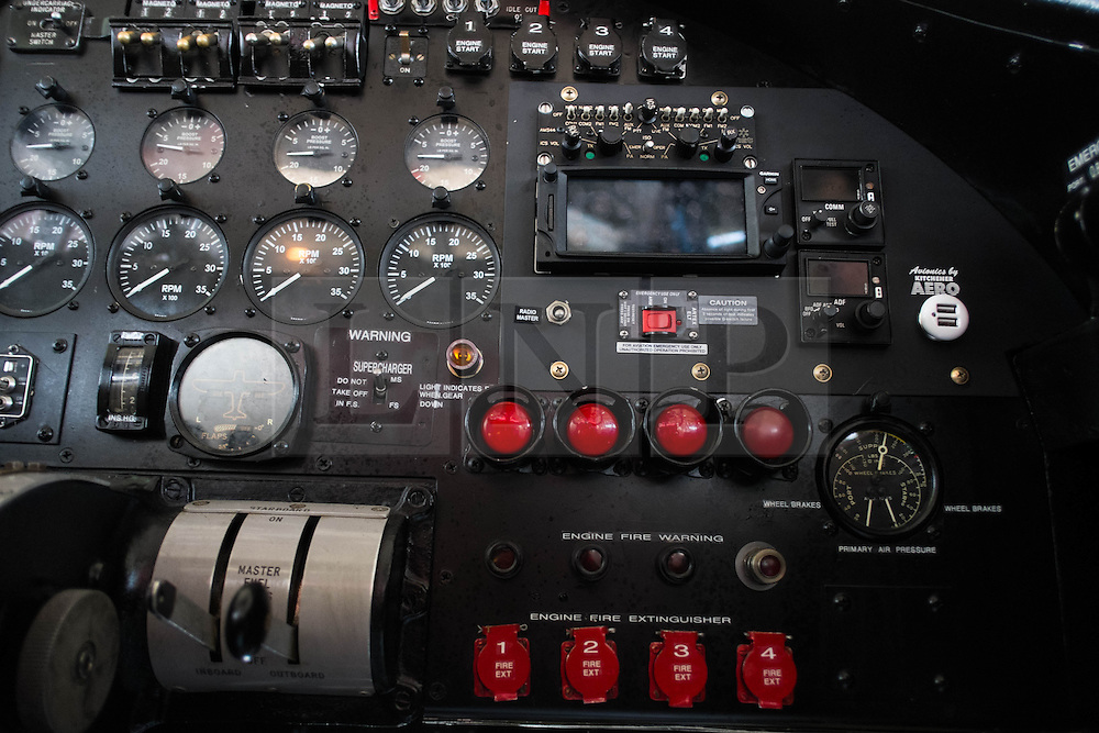 © Licensed to London News Pictures. <br /> 28/08/2014. <br /> <br /> Durham Tees Valley Airport, United Kingdom<br /> <br /> Cockpit controls inside one of only two remaining flying Avro Lancaster bombers during a visit to Durham Tees Valley airport today.  <br /> <br /> The aircraft, 'Mynarski' is named after Pilot Officer Andrew Mynarski who flew with the Canadian Royal Air Force from the airport which was then called RAF Middleton St George.<br /> <br /> Pilot Officer Mynarski was posthumously awarded a VC after giving his life while trying to save a colleague when their Lancaster was shot down in June 1944.<br /> <br /> The famous World War Two aircraft is owned by the Canadian Warplane Heritage Museum and is beginning a 2-week tour of the UK.<br /> <br /> Photo credit : Ian Forsyth/LNP