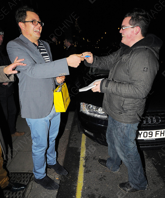 03.DECEMBER.2009 - LONDON<br /> <br /> ALAN CARR LEAVING THE AFTERPARTY AT CLARIDGES HOTEL AFTER THE PREMIERE OF NEW FILM NINE AND SIGNS AN AUTOGRAPH FOR FAN WHO LOOKS LIKE ALAN'S TWIN BUT GETS THE MIDDLE FINGER<br /> <br /> BYLINE: EDBIMAGEARCHIVE.COM<br /> <br /> *THIS IMAGE IS STRICTLY FOR UK NEWSPAPERS &amp; MAGAZINES ONLY*<br /> *FOR WORLDWIDE SALES &amp; WEB USE PLEASE CONTACT EDBIMAGEARCHIVE-0208 954 5968*