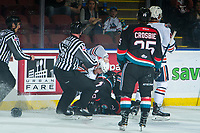 KELOWNA, CANADA - SEPTEMBER 22:  Zane Franklin #16 of the Kamloops Blazers throws a puck to Braydyn Chizen #22 of the Kelowna Rockets as ice officials skate in on September 22, 2018 at Prospera Place in Kelowna, British Columbia, Canada.  (Photo by Marissa Baecker/Shoot the Breeze)  *** Local Caption ***
