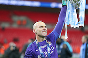 Manchester City goalkeeper Wilfredo Caballero (13)  holds the cup up during the Capital One Cup match between Liverpool and Manchester City at Anfield, Liverpool, England on 28 February 2016. Photo by Simon Davies.
