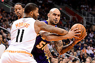 Dec 23, 2013; Phoenix, AZ, USA; Los Angeles Lakers center Robert Sacre (50) handles the ball against Phoenix Suns forward Markieff Morris (11) in the first half at US Airways Center.  The Suns won 117-90. Mandatory Credit: Jennifer Stewart-USA TODAY Sports