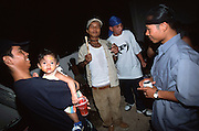 October 2004 - Phnom Penh; Cambodia - Celebrating the birthday of a deportee's one-year old child; all the guys get together at his house. Drinking beer; smoking weed and dancing to hip hop; they party the way they did back in the States. After escaping the Khmer Rouge regime to the US as refugees; many young American Cambodians are being sent back to Cambodia never to return to the US again. A new policy in 2002 meant that any US-Cambodian who still had not applied for US citizenship and had been convicted of a felony would be deported back to Cambodia after living in the US all their life. Over 1; 400 convicted felons are proposed to be sent back in the next few years and naturally the re-adjustment to a life they don't know or understand is a difficult one. Photo Credit: Luke Duggleby