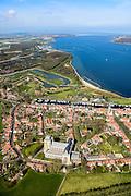 Nederland, Zeeland, Gemeente Veere 01-04-2016; Veere, voormalige visserplaats, gelegen aan het Veerse Meer. Overzicht historische binnenstad met stadhuis en Grote Kerk. De voormalige vissershaven aan de Kaai is nu jachthaven. Het Veerse Meer is ontstaan door de afdamming van het Veerse Gat in het kader van de Deltawerken waardoor Veere niet langer een verbinding heeft met de Noordzee. Veerse Gatdam aan de horizon.<br /> <br /> Veere, former fishing village, located on the Veerse Lake.<br /> <br /> luchtfoto (toeslag op standard tarieven);<br /> aerial photo (additional fee required);<br /> copyright foto/photo Siebe Swart